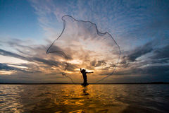 Fishermen fishing by fishnet Royalty Free Stock Images