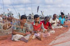 Fishermen Fishing fixing On big fishing nets. Chaktai Khal called grief of Chittagong City. It is a most important part of Chittagong sea port and Karnafuli Royalty Free Stock Photo