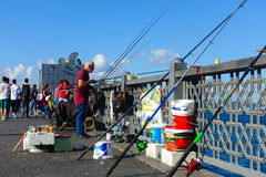 Fishermen fishing on the Galata Bridge, Istanbul, Turkey Royalty Free Stock Images
