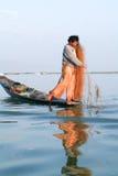 Fishermen fishing on his boat at lake Inle, Myanmar Stock Photos