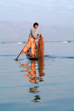 Fishermen fishing on his boat at lake Inle, Myanmar Royalty Free Stock Photography