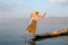 Fishermen fishing on his boat at lake Inle, Myanmar Royalty Free Stock Photo