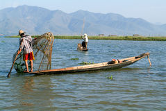 Fishermen fishing on his boat at lake Inle, Myanmar Stock Photography