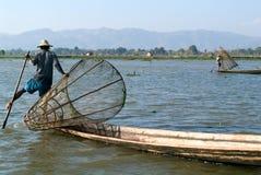 Fishermen fishing on his boat at lake Inle, Myanmar Royalty Free Stock Image