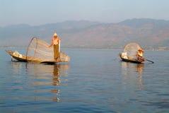 Fishermen fishing on his boat at lake Inle, Myanmar Stock Images