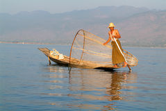 Fishermen fishing on his boat at lake Inle, Myanmar Royalty Free Stock Image