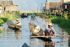 Fishermen fishing on his boat at lake Inle, Myanmar Stock Photography