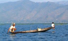 Fishermen fishing on his boat at lake Inle, Myanmar Stock Image