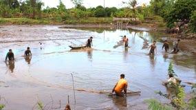 Fishermen fishing in the lagoon Stock Photos