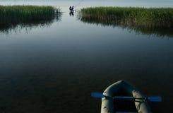 Fishermen fishing in the lake Stock Photography