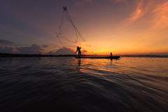 Fishermen fishing in the river silhouette Royalty Free Stock Photos