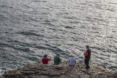 Fishermen fishing on rock Stock Image