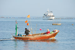 Fishermen fishing on the sea. Royalty Free Stock Images