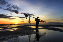 Fishermen fishing in the sea at sunrise Stock Image
