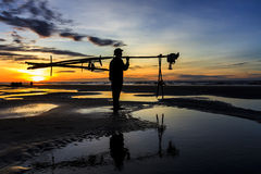 Fishermen fishing in the sea at sunrise Royalty Free Stock Image