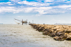 Fishermen and fishing shack on the pier Royalty Free Stock Photos