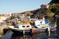 Fishermen fishing in the village of Garipçe royalty free stock photography