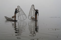 Fishermen in the fog of Inle Lake Stock Images