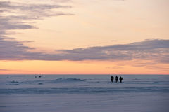 Fishermen on a frozen lake Stock Images