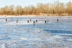 Fishermen on the Frozen River Royalty Free Stock Photo