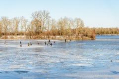 Fishermen on the Frozen River Stock Photo