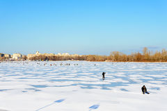 Fishermen on the Frozen River Stock Photography