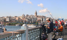 Fishermen on Galata bridge, Istanbul Stock Photos