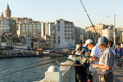 Fishermen are on the Galata Bridge on may 26, 2013 in Istanbul, Royalty Free Stock Image