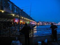 Fishermen on Galata bridge at night Royalty Free Stock Photos