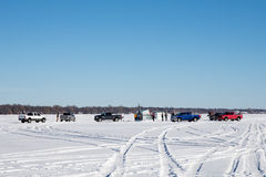 Fishermen Gathering on a Frozen Lake Royalty Free Stock Photos