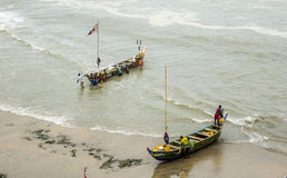 Fishermen in Ghana. Cape Coast, Ghana, West Africa - July 31, 2014: Fishermen after fishing. The main occupation of locals in this area is fishing. Photo was Royalty Free Stock Images