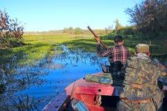 Fishermen go boating around lake for fishing. Fishing on river royalty free stock photo