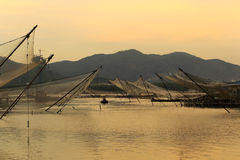 Fishermen going back by boat at dusk. Fishermen go back by boat at twilight, amoy city, china Royalty Free Stock Photos