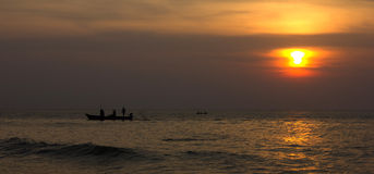 Fishermen. The fishermen going to fishing.They Are leaving at evening Royalty Free Stock Photography