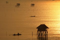 Fishermen in the golden sea,  Morning Bay Bangtabun Stock Photo