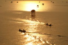 Fishermen in the golden sea,  Morning Bay Bangtabun Royalty Free Stock Image