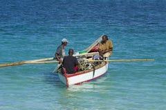 Fishermen in Grenada, Caribbean. Fishermen in a boat in Grenada Royalty Free Stock Photography
