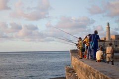 Fishermen in Habana. Some fishermen are fishing from the Castillo de los tres reyes del morro (Habana-Cuba Stock Images