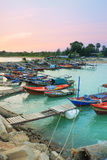 Fishermen harbor and Colorful twilight inevening over seascape a Stock Photography