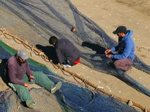 Fishermen in the harbour of Essaouira, Morocco royalty free stock photography