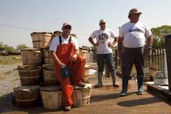 Fishermen in the harbour Stock Image
