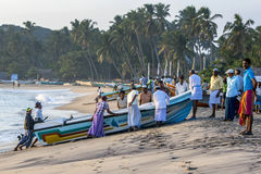 Fishermen haul their boat onto the Arugam Bay beach after a nights fishing. Arugam Bay is located on the east coast of Sri Lanka Royalty Free Stock Photography