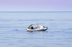 Fishermen on the high seas. September 2014,Aegean sea Greece.Happy people,satisfied with life Royalty Free Stock Image