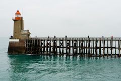 Fishermen on a high wooden pier Stock Photo