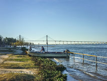 Fishermen and his Son in Parana River Stock Photos