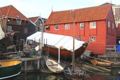 Idyllic fishing harbor with boats,Spakenburg,Netherlands. Traditional wooden fishermen houses and a botter in the harbor of fishing village Spakenburg, about 30 Stock Photos