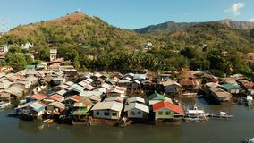 Fishermen houses on the water, Philippines, Palawan. Coron city with slums and poor district. Old wooden house standing on the sea in the fishing village. Houses royalty free stock photo