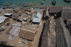 Fishermen huts and boats Stock Photos