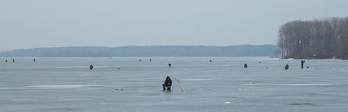 Fishermen on the ice. Of a frozen lake Royalty Free Stock Photography