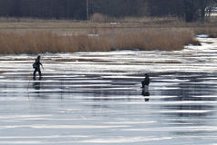 Fishermen on ice of river Royalty Free Stock Photography